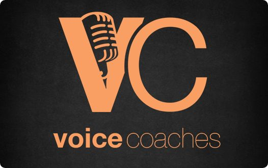 "Voice Coaches logo - ""VC"" in bubble letters with a microphone resting in the space in the V on top, ""voice coaches"" in text on the bottom"
